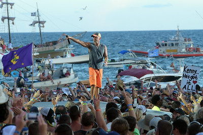 ORANGE BEACH, AL - AUGUST 16:  Kenny Chesney peforms live at Kenny Chesney's Flora-Bama-Jama, a free beachplay for 40,000 on the Florida/Alabama line, behind the historic Flora-Bama on August 16, 2014 in Orange Beach, Alabama.  (Photo by Rick Diamond/Getty Images for Kenny Chesney)